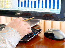 Man's hand typing at a computer keyboard. Stock Images