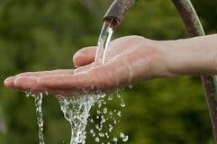 Man's hand under running  water Royalty Free Stock Photos