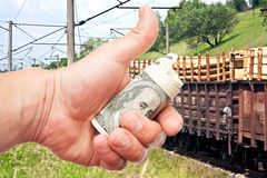 Man's hand with US dollars against the train Stock Photography