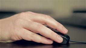 Man's hand using computer mouse. Man's hand using a wired computer mouse, clicking, scrolling and moving the device stock video