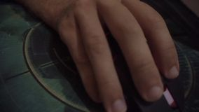 Man's hand using computer mouse while playing stock video