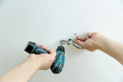 Man`s hand are using screwdrive. Stock Photography