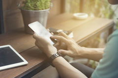 man's hand using smartphone with digital tablet Stock Photos