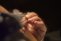 Man's hand on a violin fingerboard Stock Photos