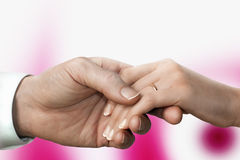 Man's hand and woman's hand with wedding ring Royalty Free Stock Photography