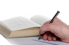 Man's hand writing on paper. On white Royalty Free Stock Image