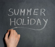 Man's hand writing Summer Holiday. Royalty Free Stock Photography