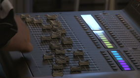 Man`s hands adjusting the sound board stock footage