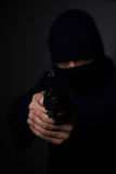 Man`s hands aiming with gun. Closeup view of man`s hands aiming with gun Royalty Free Stock Photo