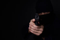 Man`s hands aiming with gun. Closeup view of man`s hands aiming with gun Royalty Free Stock Photos