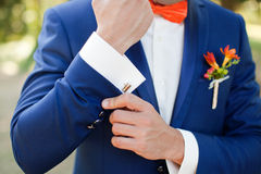 Man's hands. Bride shows beautiful cufflinks wedding day Royalty Free Stock Image