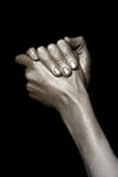 Man's hands in bronze paint Royalty Free Stock Photography