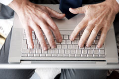 Man's Hands On Computer Keyboard Royalty Free Stock Images