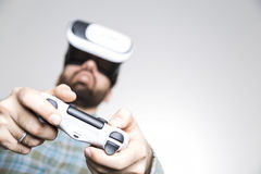 Man`s hands with controller and vr glasses Royalty Free Stock Images