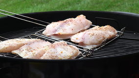 Man`s hands cooking fish fillet on grill stock footage