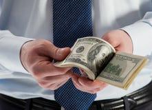 Man's hands counting dollar banknotes Royalty Free Stock Photos