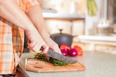 Man's hands cutting greenery Stock Photo