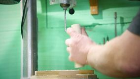 Man`s hands on a drilling machine stock video