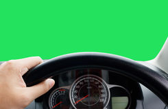 Man's hands of a driver on steering wheel of a minivan car on as. Phalt road,Inside car dashboard is green Royalty Free Stock Photos