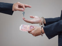 Man's hands in handcuffs and money in his palms Royalty Free Stock Images