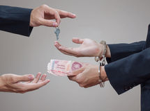 Man's hands in handcuffs and money in his palms Royalty Free Stock Image