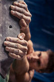 Man`s hands on handhold on artificial climbing wall Royalty Free Stock Images