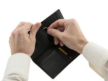 Man's hands hiding wedding ring in wallet. Adultery concept Stock Images