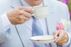 Man's hands hold a cup of coffee Royalty Free Stock Photo