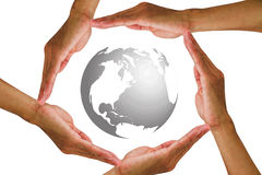 Man`s hands holding around the globe on white background stock photos