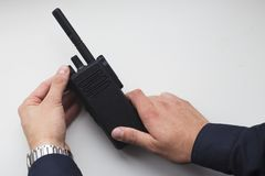 Man`s hands holding a black walkie talkie Royalty Free Stock Images
