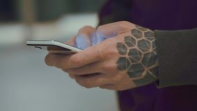Man`s hands holding cell phone. With bright screen stock footage