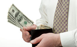 Man's hands holding dollars in leather wallet Royalty Free Stock Image
