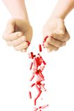 Man's hands holding and dropping a handful of medicine pills Stock Photo