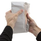 Man's hands holding envelope with banknote Royalty Free Stock Photos