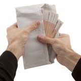 Man's hands holding envelope with banknote Royalty Free Stock Image