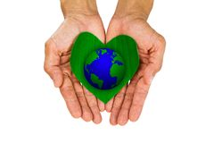 Man`s hands holding heart shaped green leaf with earth on white background Royalty Free Stock Photos