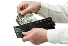 Man's hands holding leather wallet with dollars Stock Image