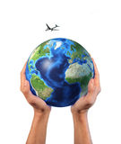 Man's hands holding the planet Earth. Man's hands holding the planet Earth, with a jet aircraft flying over it, isolated on white background, with clipping path Royalty Free Stock Photo
