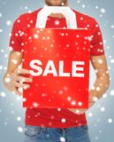 Man's hands holding shopping bag Royalty Free Stock Photography