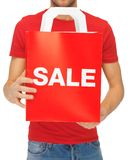 Man's hands holding shopping bag Stock Photo