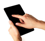 Man's hands are holding a tablet computer Stock Photos