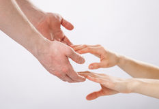 Man's hands holding woman's hands Stock Image