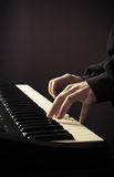 Man's hands on the keys of synthesizer Stock Photography