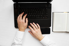 Man`s hands with laptop notebook Royalty Free Stock Photo