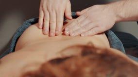 Man`s hands massaging woman`s back Stock Photos
