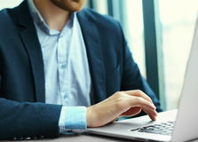 Man's hands on notebook computer, business person at workplace. Young man working with laptop, man's hands on notebook computer, business person at workplace Royalty Free Stock Photography