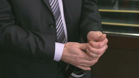 Man's hands opening wine bottle using corkscrew stock video