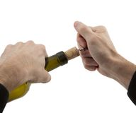 Man's hands opens bottle of wine Royalty Free Stock Images