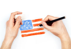 Man's hands with pencil draws flag of USA on white Royalty Free Stock Images