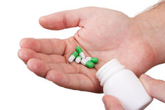 Man's hands with pills Stock Photography